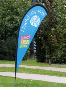 A feather banner marks the site of the 'mindful labyrinth' for Addenbrooke's Hospital Mental Health Resilience Week
